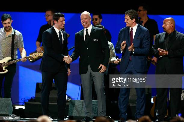 Sidney Crosby of the Pittsburgh Penguins former NHL players Mark Messier Brendan Shanahan and Grant Fuhr take the stage during the 2017 NHL Awards...