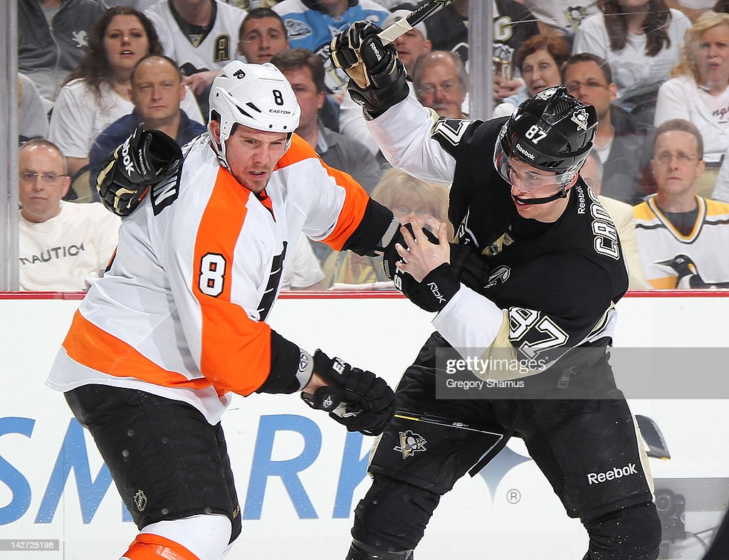 Sidney Crosby #87 of the Pittsburgh Penguins gets hit by Nicklas Grossmann #8 of the Philadelphia Flyers and looses his glove in Game One of the Eastern Conference Quarterfinals during the 2012 NHL Stanley Cup Playoffs at Consol Energy Center on April 11, 2012 in Pittsburgh, Pennsylvania.