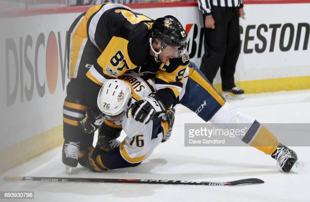 Sidney Crosby of the Pittsburgh Penguins gets PK Subban of the Nashville Predators down to the ice during the first period of Game Five of the 2017...