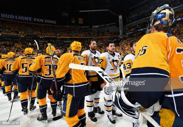 Sidney Crosby of the Pittsburgh Penguins goes through the hand shake line after the Penguins defeated the Predators 20 to win the 2017 NHL Stanley...