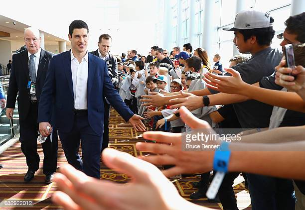 Sidney Crosby of the Pittsburgh Penguins greets young fans as he arrives at 2017 NHL AllStar Media Day as part of the 2017 NHL AllStar Weekend at the...