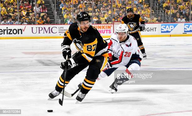 Sidney Crosby of the Pittsburgh Penguins handles the puck against Lars Eller of the Washington Capitals in Game Four of the Eastern Conference Second...