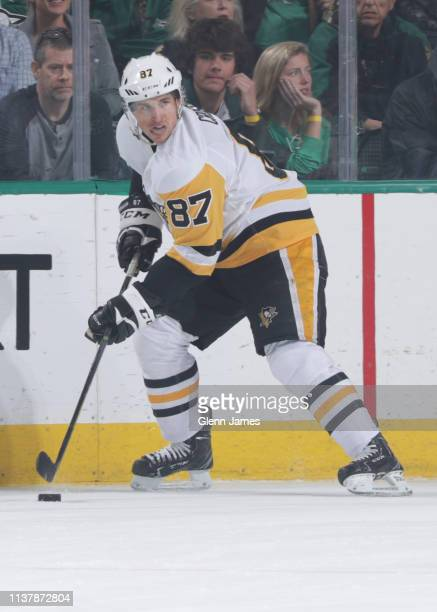 Sidney Crosby of the Pittsburgh Penguins handles the puck against the Dallas Stars at the American Airlines Center on March 23 2019 in Dallas Texas