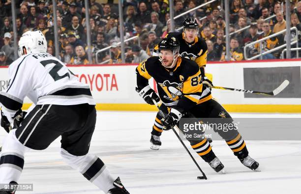 Sidney Crosby of the Pittsburgh Penguins handles the puck against the Los Angeles Kings at PPG Paints Arena on February 15 2018 in Pittsburgh...