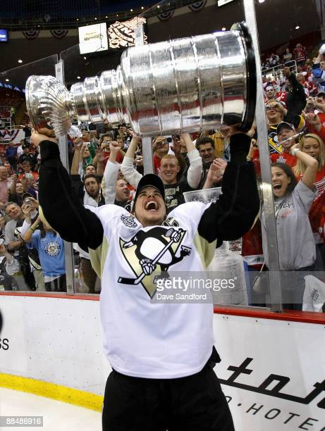 Sidney Crosby of the Pittsburgh Penguins hoists the Stanley Cup following a 2-1 victory over the Detroit Red Wings during Game Seven of the 2009...