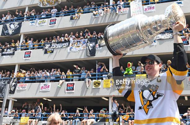 Sidney Crosby of the Pittsburgh Penguins hoists the Stanley Cup during the Victory Parade and Rally on June 14 2017 in Pittsburgh Pennsylvania