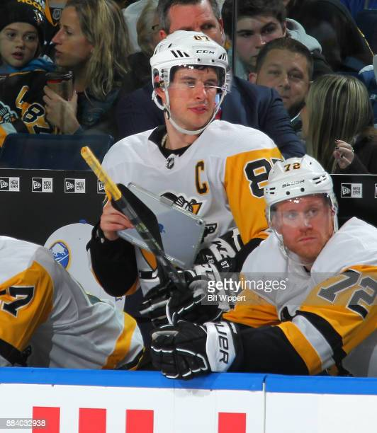Sidney Crosby of the Pittsburgh Penguins holds a tablet on the bench during an NHL game against the Buffalo Sabres on December 1 2017 at KeyBank...