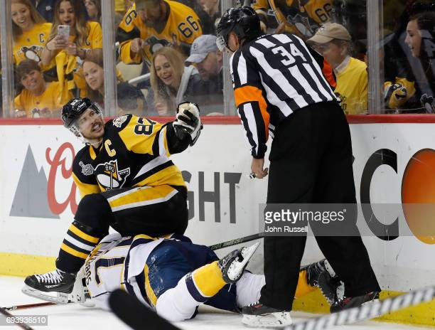 Sidney Crosby of the Pittsburgh Penguins holds down PK Subban of the Nashville Predators during the first period of Game Five of the 2017 NHL Stanley...