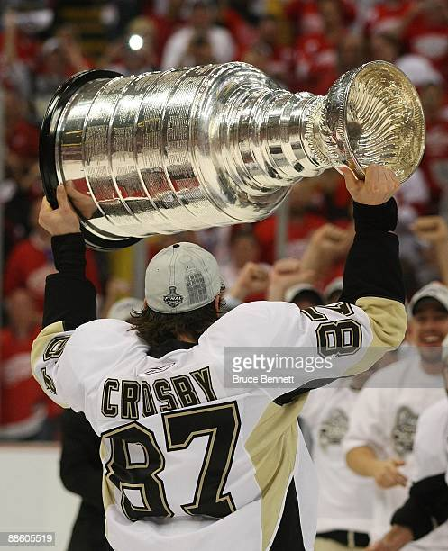 Sidney Crosby of the Pittsburgh Penguins holds the Stanley Cup following the Penguins victory over the Detroit Red Wings in Game Seven of the 2009...