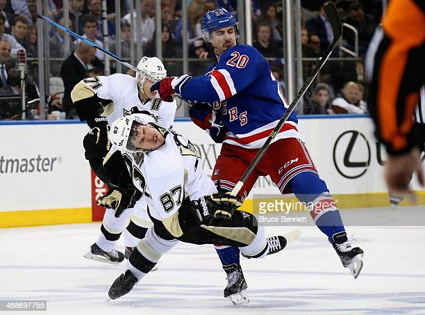 Sidney Crosby of the Pittsburgh Penguins is checked by Chris Kreider of the New York Rangers during Game Four of the Second Round in the 2014 NHL...