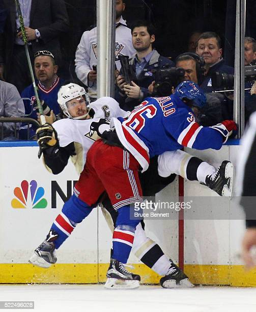 Sidney Crosby of the Pittsburgh Penguins is checked by Mats Zuccarello of the New York Rangers during the first period in Game Three of the Eastern...