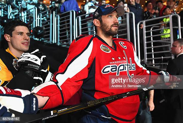 Sidney Crosby of the Pittsburgh Penguins left and Alex Ovechkin of the Washington Capitals wait to take the ice for the 2017 Coors Light NHL AllStar...