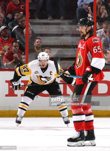 Sidney Crosby of the Pittsburgh Penguins looks on as Erik Karlsson of the Ottawa Senators skates past during the first period in Game Four of the...