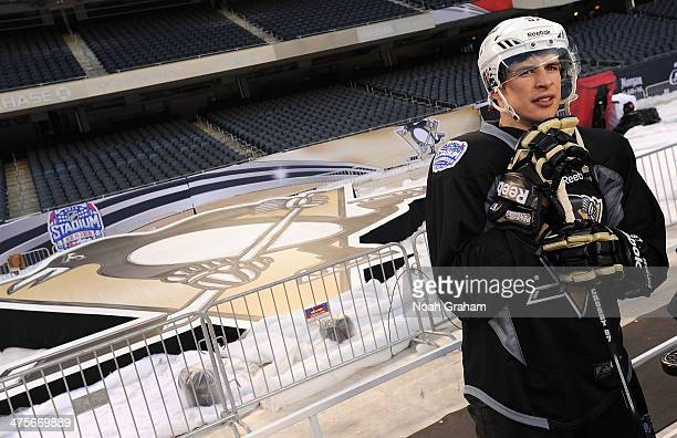 Sidney Crosby of the Pittsburgh Penguins looks on during the 2014 NHL Stadium Series family skate at Soldier Field on February 28 2014 in Chicago...