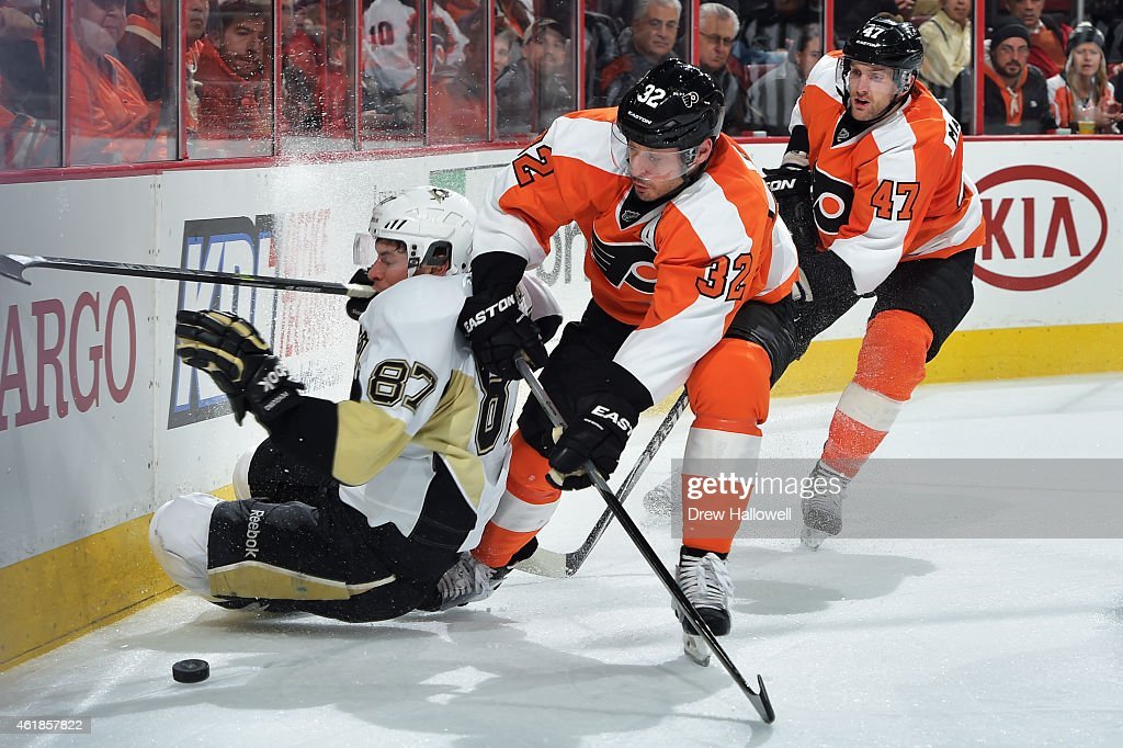 Sidney Crosby #87 of the Pittsburgh Penguins loses an edge going for the puck against Mark Streit #32 and Andrew MacDonald #47 of the Philadelphia Flyers at the Wells Fargo Center on January 20, 2015 in Philadelphia, Pennsylvania. The Flyers won 3-2 in overtime.