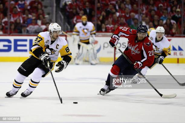 Sidney Crosby of the Pittsburgh Penguins moves the puck in front of Lars Eller of the Washington Capitals in the second period in Game Seven of the...