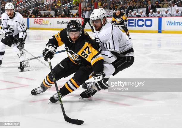 Sidney Crosby of the Pittsburgh Penguins moves the puck in front of Anze Kopitar of the Los Angeles Kings at PPG Paints Arena on February 15 2018 in...