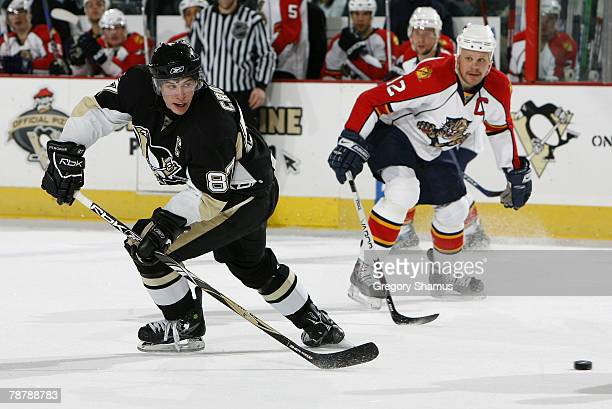 Sidney Crosby of the Pittsburgh Penguins moves the puck up ice in front of Olli Jokinen of the Florida Panthers on January 5 2008 at Mellon Arena in...
