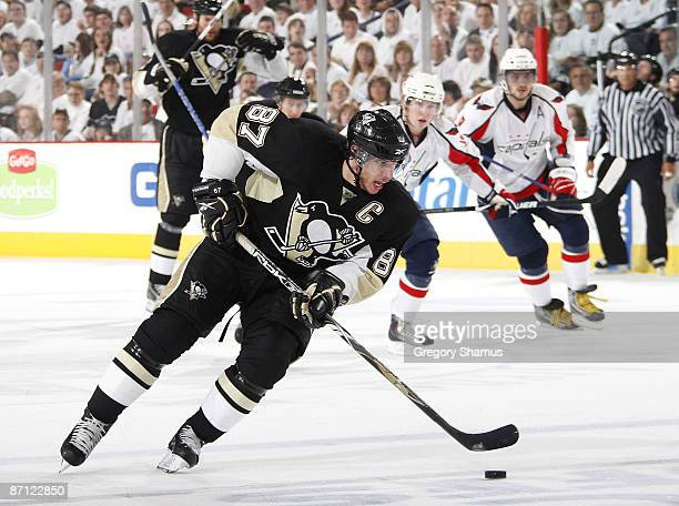 Sidney Crosby of the Pittsburgh Penguins moves the puck up ice in front of Alex Ovechkin of the Washington Capitals during Game Six of the Eastern...