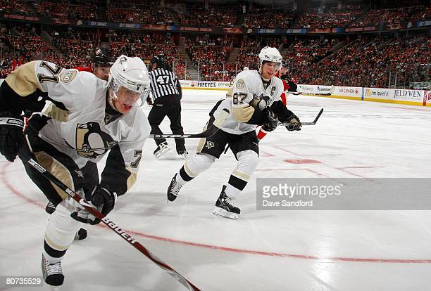 Sidney Crosby of the Pittsburgh Penguins paces the play of teammate Evgeni Malkin during game three of the 2008 NHL Eastern Conference Quarterfinals...