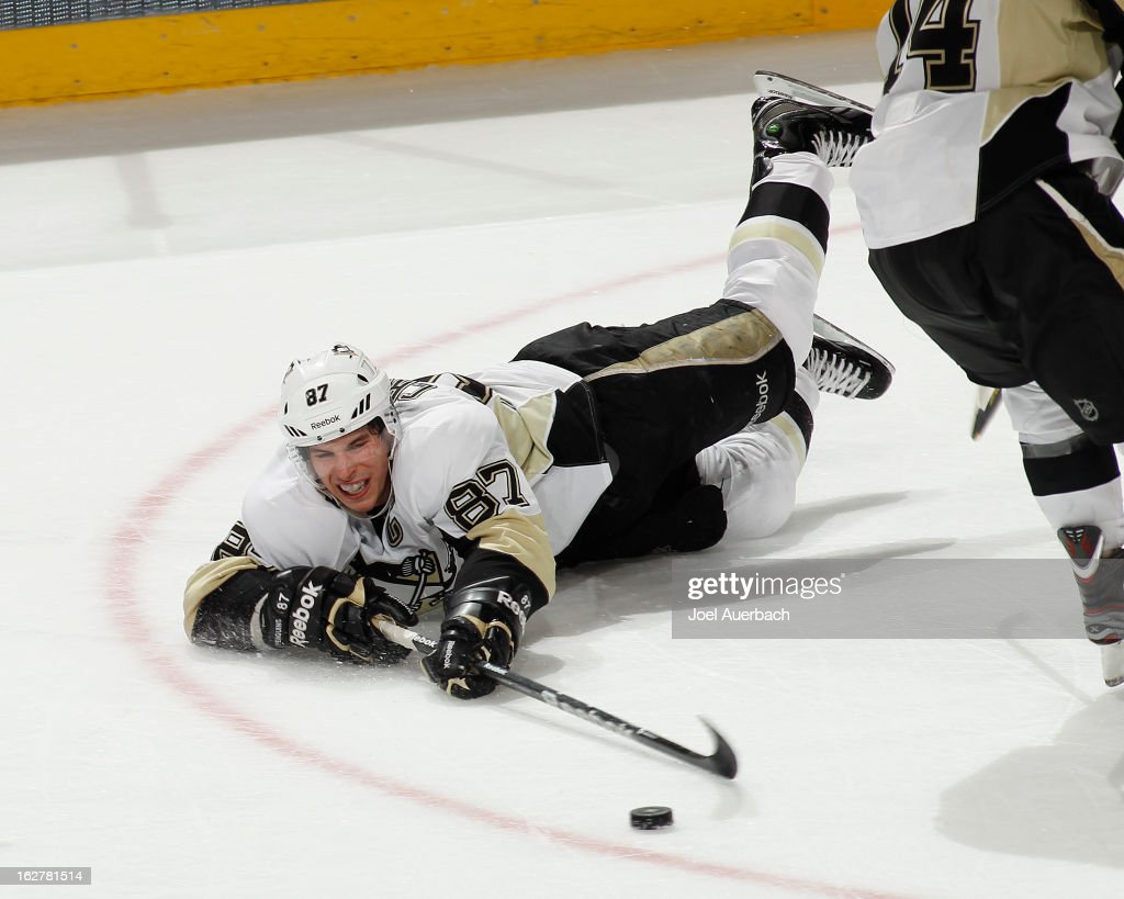 Sidney Crosby #87 of the Pittsburgh Penguins passes the puck after he was checked to the ice by the Florida Panthers at the BB&T Center on February 26, 2013 in Sunrise, Florida. The Panthers defeated the Penguins 6-4.