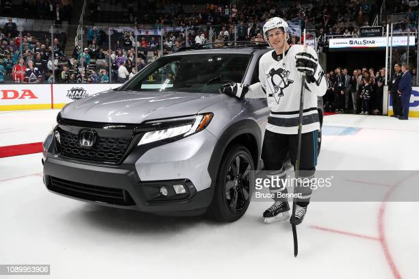 Sidney Crosby of the Pittsburgh Penguins poses after being awarded a car after for winning the MVP award during the 2019 Honda NHL AllStar Game at...
