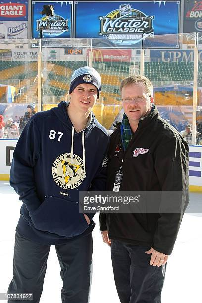 Sidney Crosby of the Pittsburgh Penguins poses for a photo with his former Coal Harbor coach Paul Mason during a family skate following practice for...