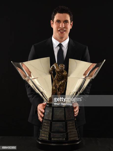 "Sidney Crosby of the Pittsburgh Penguins poses for a portrait with The Maurice ""Rocket"" Richard Trophy at the 2017 NHL Awards at T-Mobile Arena on..."