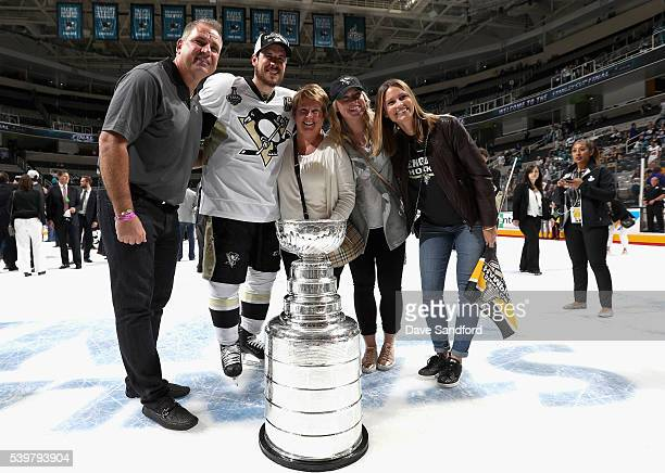 Sidney Crosby of the Pittsburgh Penguins poses with his family and the Stanley Cup after the Penguins won Game 6 of the 2016 NHL Stanley Cup Final 31...