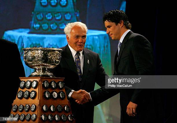 Sidney Crosby of the Pittsburgh Penguins poses with the Art Ross Trophy as presented by Henri Richard Hockey Hall of Famer during the NHL Awards...