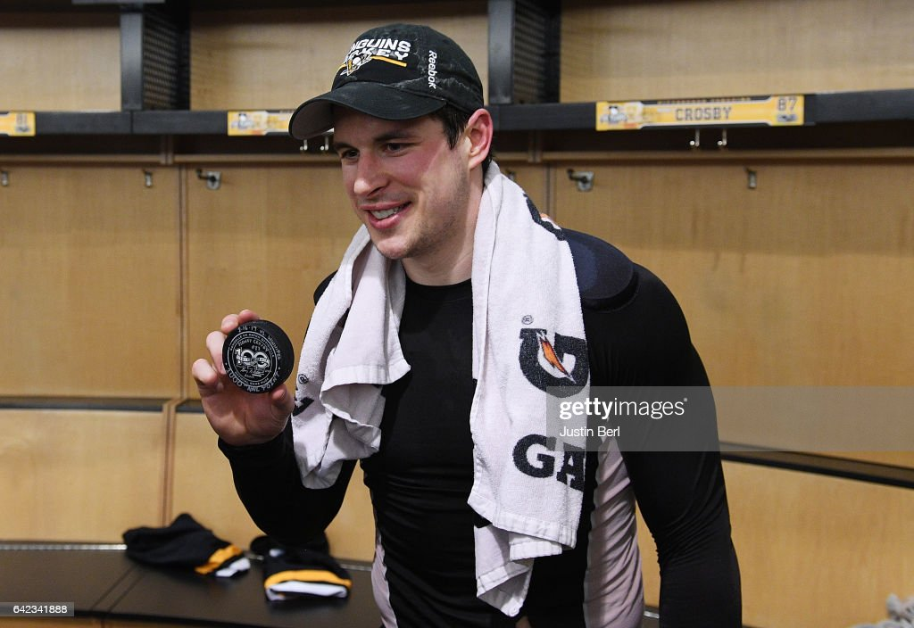 Sidney Crosby #87 of the Pittsburgh Penguins poses with the puck he scored his 1000th career point with after the Pittsburgh Penguins 4-3 win over the Winnipeg Jets in overtime at PPG PAINTS Arena on February 16, 2017 in Pittsburgh, Pennsylvania.