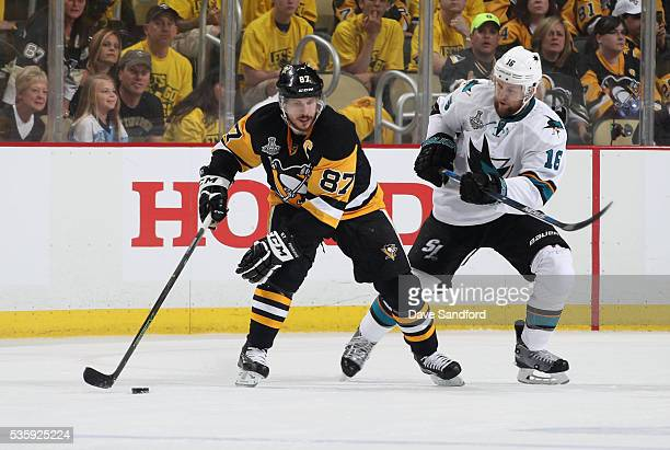 Sidney Crosby of the Pittsburgh Penguins protects the puck from Nick Spaling of the San Jose Sharks during the first period of Game One of the 2016...