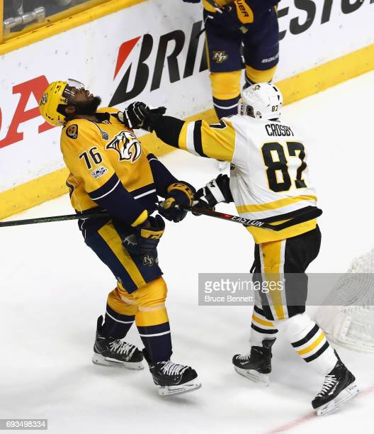 Sidney Crosby of the Pittsburgh Penguins pushes PK Subban of the Nashville Predators in Game Four of the 2017 NHL Stanley Cup Final at the...