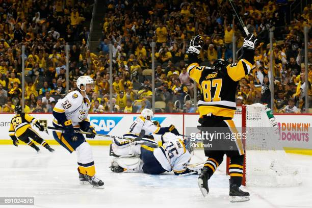 Sidney Crosby of the Pittsburgh Penguins reacts to a goal by Jake Guentzel during the third period in Game Two of the 2017 NHL Stanley Cup Final...