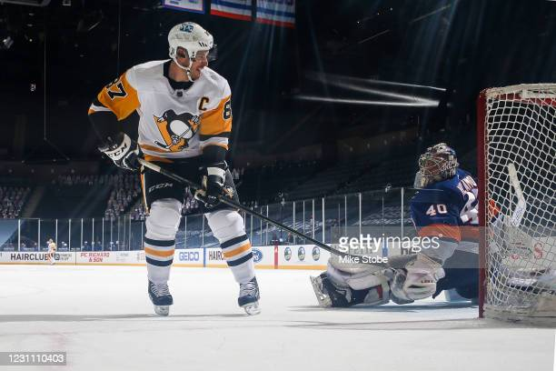 Sidney Crosby of the Pittsburgh Penguins scores a goal during the shootout past Semyon Varlamov of the New York Islanders at Nassau Coliseum on...