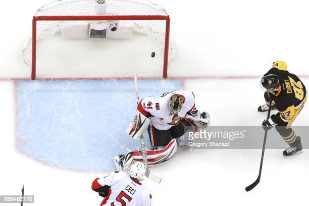 Sidney Crosby of the Pittsburgh Penguins scores a goal on Craig Anderson of the Ottawa Senators during the first period in Game Five of the Eastern...