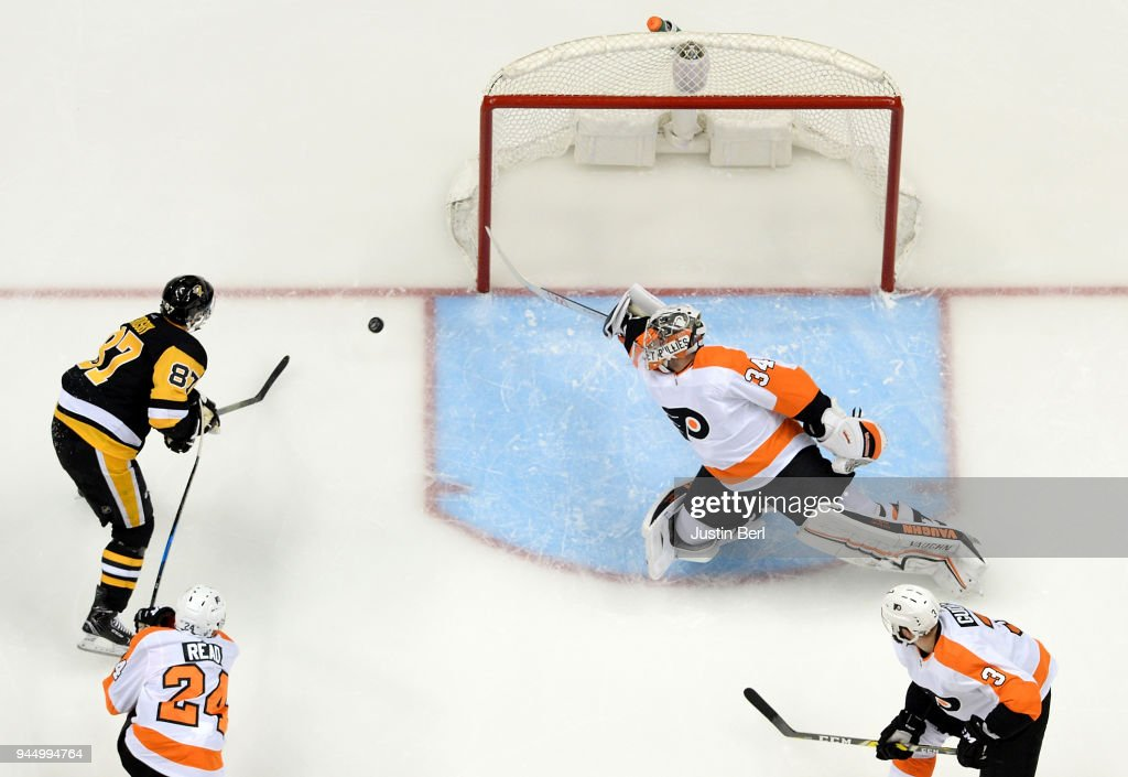 Sidney Crosby #87 of the Pittsburgh Penguins scores a goal past Petr Mrazek #34 of the Philadelphia Flyers during the third period in Game One of the Eastern Conference First Round during the 2018 NHL Stanley Cup Playoffs at PPG PAINTS Arena on April 11, 2018 in Pittsburgh, Pennsylvania.