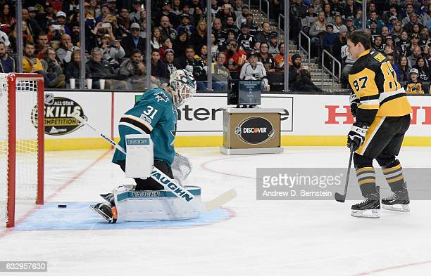 Sidney Crosby of the Pittsburgh Penguins scores against goaltender Martin Jones of the San Jose Sharks during the Discover NHL Shootout as part of...