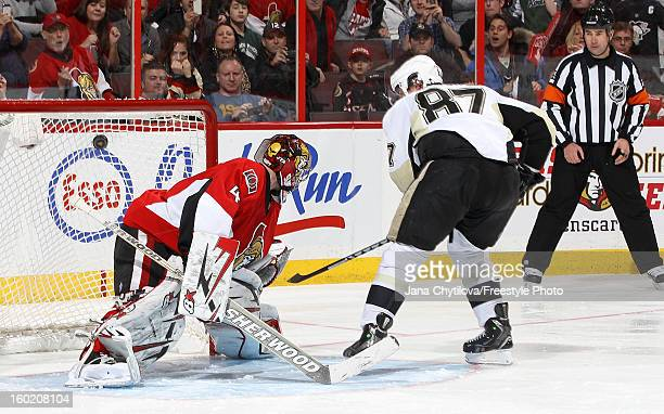Sidney Crosby of the Pittsburgh Penguins scores on Craig Anderson of the Ottawa Senators in a shootout during an NHL game at Scotiabank Place on...