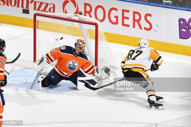 Sidney Crosby of the Pittsburgh Penguins scores the game winning goal on Cam Talbot of the Edmonton Oilers on October 23 2018 at Rogers Place in...