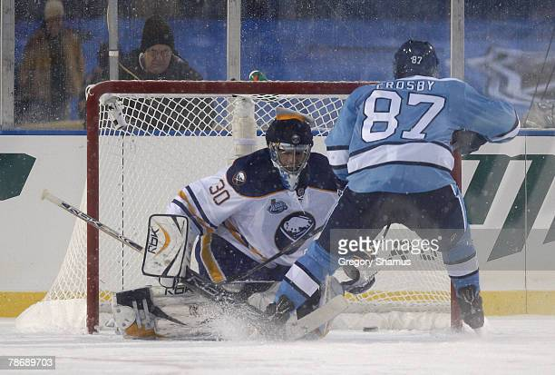 Sidney Crosby of the Pittsburgh Penguins scores the game winning shoutout goal against Ryan Miller of the Buffalo Sabres at the NHL Winter Classic on...