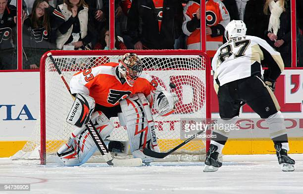 Sidney Crosby of the Pittsburgh Penguins scores the game winning shootout goal against Brian Boucher of the Philadelphia Flyers on December 17 2009...