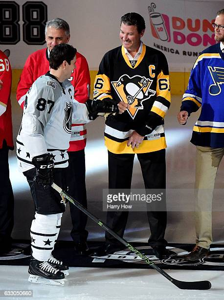 Sidney Crosby of the Pittsburgh Penguins shakes hands with former NHL player Mario Lemieux prior to the 2017 Honda NHL AllStar Game Semifinal at...