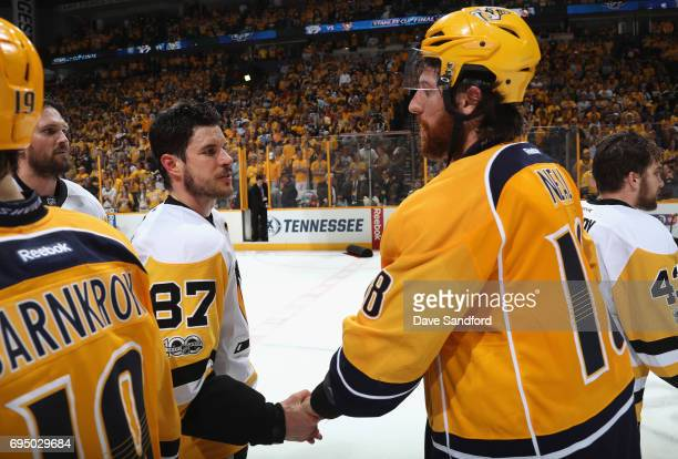 Sidney Crosby of the Pittsburgh Penguins shakes hands with James Neal of the Nashville Predators after the Penguins defeated the Predators 20 to win...