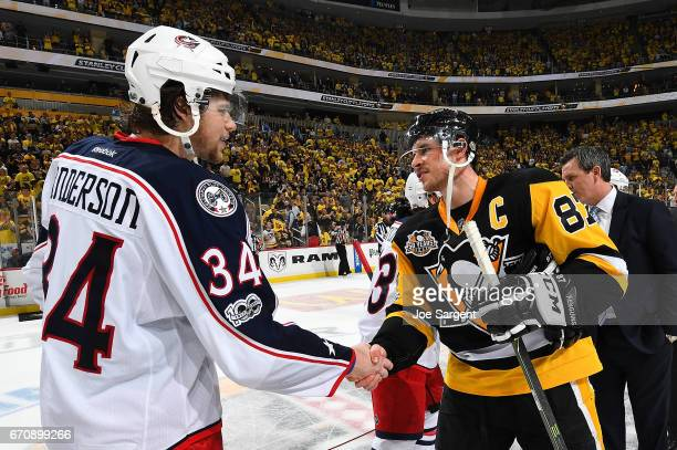 Sidney Crosby of the Pittsburgh Penguins shakes hands with Josh Anderson of the Columbus Blue Jackets after a 52 win in Game Five of the Eastern...