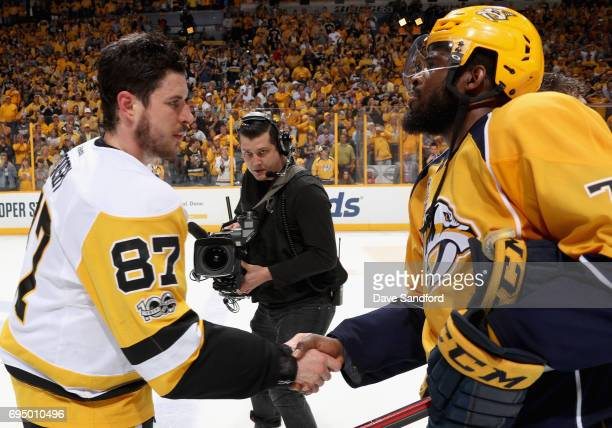 Sidney Crosby of the Pittsburgh Penguins shakes hands with PK Subban of the Nashville Predators after the Penguins defeated the Nashville Predators...