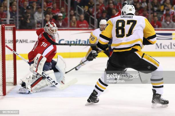 Sidney Crosby of the Pittsburgh Penguins shoots on goalie Braden Holtby of the Washington Capitals during the first period in Game Two of the Eastern...