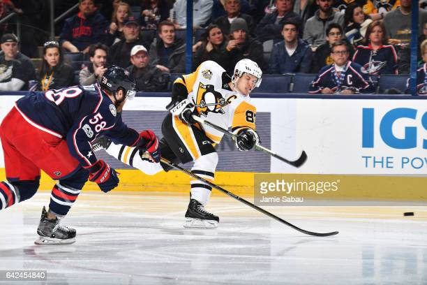 Sidney Crosby of the Pittsburgh Penguins shoots the puck past David Savard of the Columbus Blue Jackets during the second period of a game on...