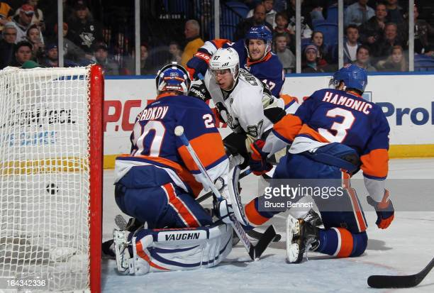 Sidney Crosby of the Pittsburgh Penguins shoots wide of the New York Islanders net during the first period at the Nassau Veterans Memorial Coliseum...