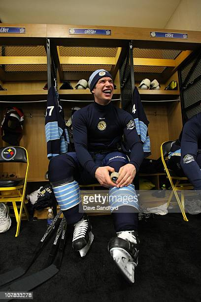 Sidney Crosby of the Pittsburgh Penguins sits in the locker room prior to practice for the 2011 NHL Bridgestone Winter Classic at Heinz Field on...